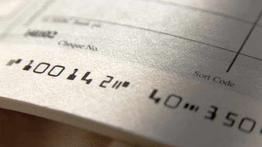 a close up of an unwritten cheque in a cheque book